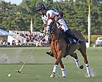 WELLINGTON, FL - JANUARY 08:  #3 Inaki LaPrida of the Grand Champions Polo Club, takes control of the ball, against Coca Cola, during the early rounds of the Joe Barry Memorial Cup, at the International Polo Club, Palm Beach on January 03, 2017 in Wellington, Florida. (Photo by Liz Lamont/Eclipse Sportswire/Getty Images)