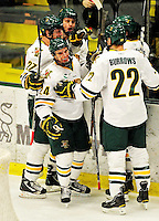 5 February 2011: University of Vermont Catamount forward Tobias Nilsson-Roos (24), a Sophomore from Malmo, Sweden, smiles as he celebrates Vermont's 7th goal against the Providence College Friars at Gutterson Fieldhouse in Burlington, Vermont. The Catamounts defeated the Friars 7-1 in the second game of their weekend series. Mandatory Credit: Ed Wolfstein Photo