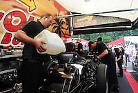 Aug. 7, 2011; Kent, WA, USA; NHRA funny car crew members for driver Melanie Troxel during the Northwest Nationals at Pacific Raceways. Mandatory Credit: Mark J. Rebilas-