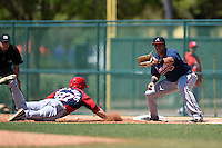 Atlanta Braves first baseman Edison Sanchez (72) takes a pick off throw as Will Piwnica-Worms (27) dives back to first during a minor league spring training game against the Washington Nationals on March 26, 2014 at Wide World of Sports in Orlando, Florida.  (Mike Janes/Four Seam Images)