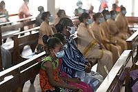 MAURITANIA, Nouakchott, corona pandemic, mass in church with masks / MAURETANIEN, Nuakschott, katholische Kirche, Kathedrale, Corona Pandemie, Messe mit Maske