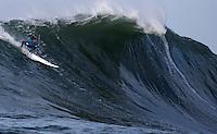 Half Moon Bay, California - January 24, 2014: 2014 Maverick's Invitational Carlos Burle at the top.