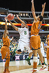 guard Niya Johnson (2) drives past center Imani McGee-Stafford (34) during Big 12 women's basketball championship final, Sunday, March 08, 2015 in Dallas, Tex. (Dan Wozniak/TFV Media via AP Images)