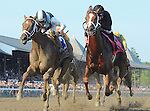 Curalina (no. 3), ridden by John Velazquez and trained by Todd Pletcher, wins the 98th running of the grade 1 Coaching Club American Oaks for three year old fillies by disqualification of I'm a Chatterbox (no. 8), ridden by Florent Geroux and trained by J. Larry Jones, on July 26, 2015 at Saratoga Race Course in Saratoga Springs, New York. (Bob Mayberger/Eclipse Sportswire)