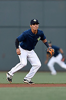 Shortstop Andres Gimenez (13) of the Columbia Fireflies plays defense in a game against the Lexington Legends on Thursday, June 8, 2017, at Spirit Communications Park in Columbia, South Carolina. Columbia won, 8-0. (Tom Priddy/Four Seam Images)