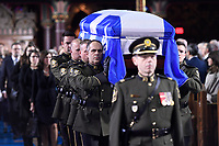 The casket of former Quebec premier Bernard Landry is carried into Notre-Dame Basilica for his funeral service in Montreal on Tuesday, November 13, 2018. THE CANADIAN PRESS/Paul Chiasson
