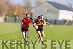 Kenmare's Griffin Wharton and  Stacks Joseph O'Connor tussle for possession during their encounter in Division 1 of the County Football league on Sunday