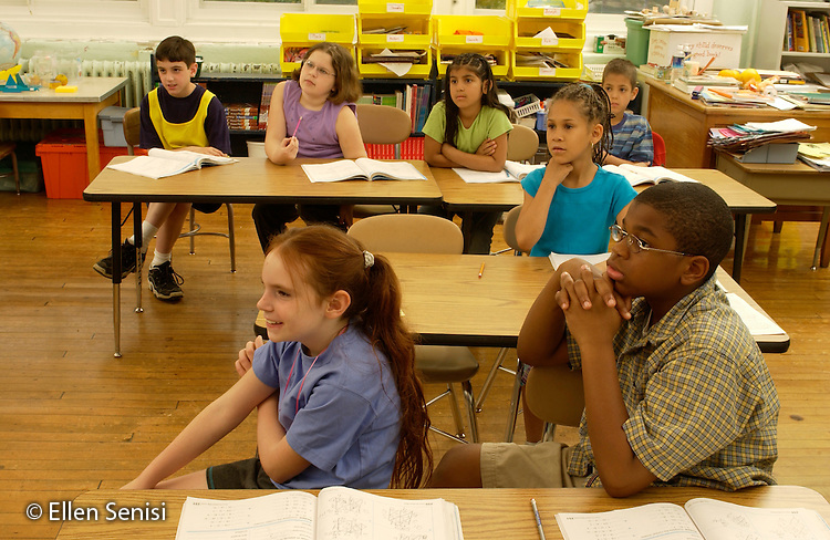 MR / Schenectady,NY.Yates Arts-in-Education Magnet School, urban public school, Grade 3.Students listen during math lesson..Class includes several mainstreamed students with special needs..MR: L-C-3.©Ellen B. Senisi