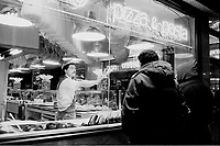 January ,1987 File Photo - New-York (NY) USA -  Pizza on Time Square at night