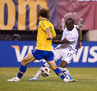 Jozy Altidore (17) of the USMNT tries to get past David Luiz (4) of Brazil during an international friendly at the New Meadowlands Stadium in East Rutherford, NJ. Brazil defeated the USMNT, 2-0.