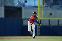 Charleston RiverDogs shortstop Johan Lopez (32) makes a throw to first base against the Kannapolis Cannon Ballers at Atrium Health Ballpark on June 30, 2021 in Kannapolis, North Carolina. (Brian Westerholt/Four Seam Images)