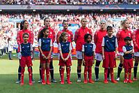 PARIS,  - JUNE 16: Christen Press #23, Tierna Davidson #12, Ali Krieger #11, Lindsey Horan #9, and Julie Ertz #8 stand for the national anthem during a game between Chile and USWNT at Parc des Princes on June 16, 2019 in Paris, France.