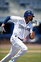 Charlotte Stone Crabs Zach Rutherford (15) runs to first base during a Florida State League game against the Dunedin Blue Jays on April 17, 2019 at Charlotte Sports Park in Port Charlotte, Florida.  Charlotte defeated Dunedin 4-3.  (Mike Janes/Four Seam Images)