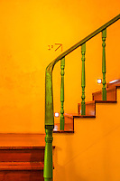 A Catholic Church in Macow, China was open to the public and included this stair well colored in the bright yellow and green typical of the Portuguese.
