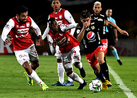 BOGOTA-COLOMBIA, 21-02-2020: Andres Perez, Carlos Arboleda de Independiente Santa Fe y Matias Pisano de America de Cali disputan el balon durante partido de la fecha 6 entre Independiente Santa Fe y America de Cali, por la Liga BetPLay DIMAYOR I 2020, en el estadio Nemesio Camacho El Campin de la ciudad de Bogota. / Andres PerezCarlos Arboleda of Independiente Santa Fe and Matias Pisano of America de Cali vie for the ball during a match of the 6th date between Independiente Santa Fe and America de Cali, for the BetPlay DIMAYOR I Leguaje 2020 at the Nemesio Camacho El Campin Stadium in Bogota city. / Photo: VizzorImage / Luis Ramirez / Staff.