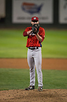 Orem Owlz relief pitcher Jake Lee (30) looks in for the sign during a Pioneer League game against the Helena Brewers at Kindrick Legion Field on August 21, 2018 in Helena, Montana. The Orem Owlz defeated the Helena Brewers by a score of 6-0. (Zachary Lucy/Four Seam Images)