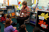 MR / Schenectady, NY.Yates Arts in Education Magnet School, Grade 2.Arts-Themed Urban Elementary School.Teacher reads aloud to students at storytime..MR: g2c.© Ellen B. Senisi