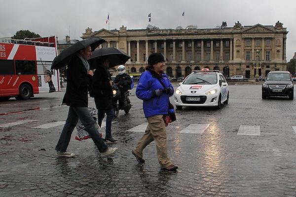 Beth walking in the rain at Place de la Concorde and Avenue da la Champs Elysees, Paris, France.