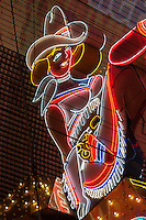 Las Vegas, Nevada.  Fremont Street.  Neon Cowgirl Sign.