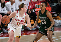 COLLEGE PARK, MD - DECEMBER 8: Alexis Gray #20 of Loyola defends against Taylor Mikesell #11 of Maryland during a game between Loyola University and University of Maryland at Xfinity Center on December 8, 2019 in College Park, Maryland.