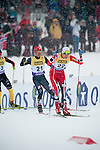 HOLMENKOLLEN, OSLO, NORWAY - March 16: (R-L) Joergen Graabak of Norway (NOR) and Bryan Fletcher of USA during the cross country 15 km (2 x 7.5 km) competition at the FIS Nordic Combined World Cup on March 16, 2013 in Oslo, Norway. (Photo by Dirk Markgraf)