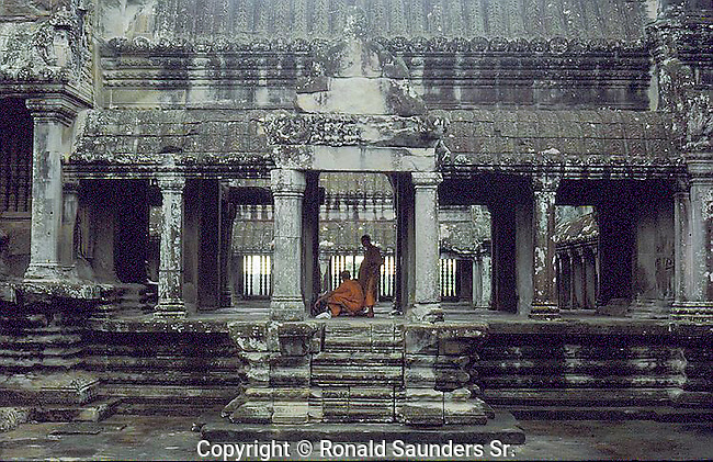 Angkor Wat (Khmer: អង្គរវត្ត) was first a Hindu, then subsequently a Buddhist, temple complex in Cambodia and the largest religious monument in the world. The temple was built by the Khmer King Suryavarman II in the early 12th century in Yaśodharapura (Khmer: យសោធរបុរៈ, present-day Angkor), the capital of the Khmer Empire, as his state temple and eventual mausoleum. Breaking from the Shaiva tradition of previous kings, Angkor Wat was instead dedicated to Vishnu. As the best-preserved temple at the site, it is the only one to have remained a significant religious center since its foundation. The temple is at the top of the high classical style of Khmer architecture. It has become a symbol of Cambodia,[1]Angkor Wat (Khmer: អង្គរវត្ត) was first a Hindu, then subsequently a Buddhist, temple complex in Cambodia and the largest religious monument in the world. The temple was built by the Khmer King Suryavarman II in the early 12th century in Yaśodharapura (Khmer: យសោធរបុរៈ, present-day Angkor), the capital of the Khmer Empire, as his state temple and eventual mausoleum. Breaking from the Shaiva tradition of previous kings, Angkor Wat was instead dedicated to Vishnu. As the best-preserved temple at the site, it is the only one to have remained a significant religious center since its foundation. The temple is at the top of the high classical style of Khmer architecture. It has become a symbol of Cambodia,[1] appearing on its national flag, and it is the country's prime attraction for visitors. appearing on its national flag, and it is the country's prime attraction for visitors.