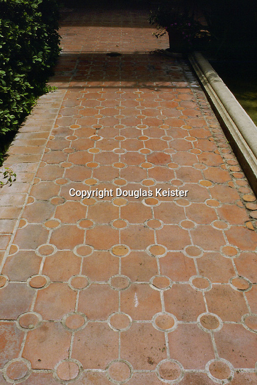 sp35207, sp35266, sp35196  (different paving)<br /><br />These paving patterns illustrate the variety textures and designs that can be obtained from simple Spanish Revival paving materials such as brick and clay tile.  Clockwise from top left:  crosses and circles bordered by a brick header course; hexagonal clay tile with incised and painted relief; and a herringbone pattern bordered by brick stretchers.