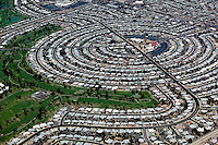 aerial photograph of a suburban residential circular housing tract adjacent to a golf course in Phoenix, Arizona