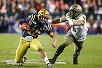 Philadelphia, PA - December 14, 2019:     Navy Midshipmen quarterback Malcolm Perry (10) jukes the Army Black Knights defender during the 120th game between Army vs Navy at Lincoln Financial Field in Philadelphia, PA. (Photo by Elliott Brown/Media Images International)