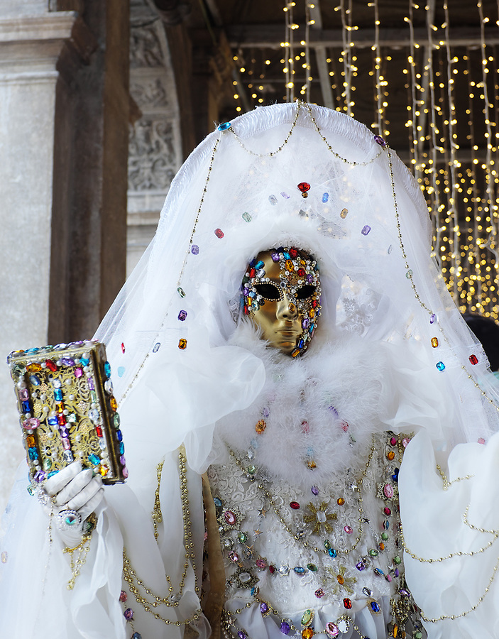 Woman dressed in traditional mask and costume for Venice Carnival, Piazza San Marco, Venice, Veneto, Italy