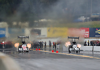 Sep 14, 2019; Mohnton, PA, USA; NHRA top fuel driver Clay Millican (left) races alongside Mike Salinas during qualifying for the Reading Nationals at Maple Grove Raceway. Mandatory Credit: Mark J. Rebilas-USA TODAY Sports