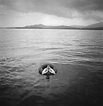 Brendan Works in innertube, Moosehead Lake, ME.