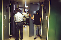 Switzerland. Bern. Regionalfgefängnis. Jail. Detention awaiting trial (commital for trial or pending trial). Loss of liberty.  Cells doors. View on the corridor,the door cells, some prisoners and the prison warder Mr. Burkhart. © 2005 Didier Ruef