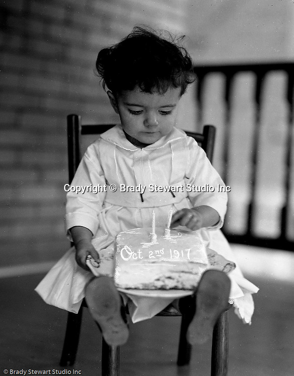 Wilkinsburg PA:  Helen Stewart celebrating her second birthday with a cake on the front porch.