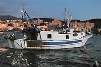 - island of Pantelleria, fishing boat returns in port ....- isola di Pantelleria, peschereccio rientra in porto
