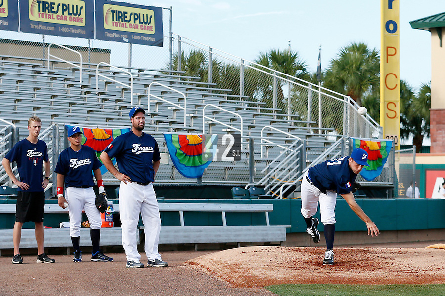 20 September 2012: Quentin Pourcel is seen in the bullpen, while Eric Gagne, Boris Marche and Ben Cates watch prior to Spain 8-0 win over France, at the 2012 World Baseball Classic Qualifier round, in Jupiter, Florida, USA.