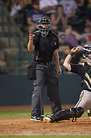 Home plate umpire Brandon Blome makes a strike call during the South Atlantic League game between the Kannapolis Intimidators and the Hickory Crawdads at L.P. Frans Stadium on July 20, 2018 in Hickory, North Carolina. The Crawdads defeated the Intimidators 4-1. (Brian Westerholt/Four Seam Images)