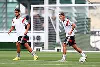 Sami Khedira and Mesut Ozil of Germany during training ahead of tomorrow's World Cup Final