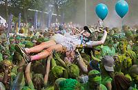 Asian Woman Crowd Surfing at Color Run Music Concert, Seattle Center, Washington State, WA, America, USA.