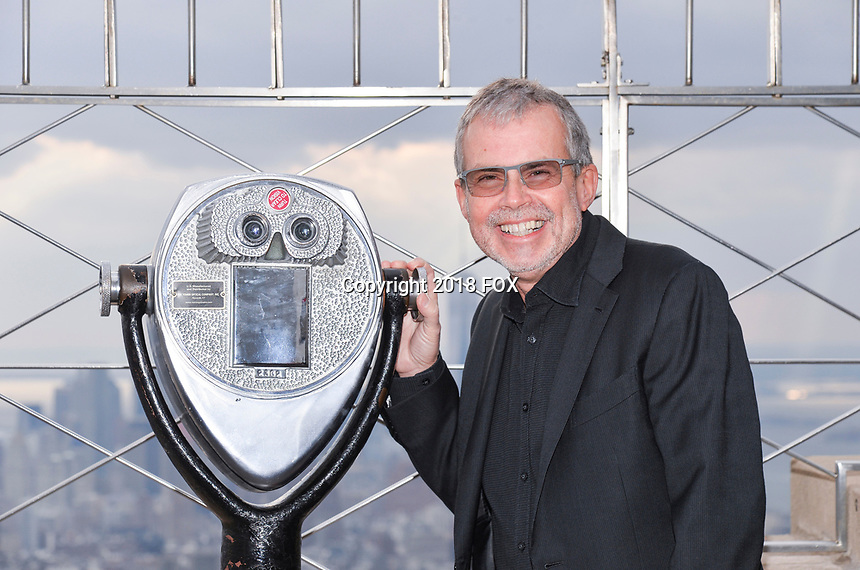 """New York - DECEMBER 17: Mike Scully participates in the ceremonial lighting of the Empire State Building as they attend the Empire State Building Celebration of the 30th Anniversary of FOX's """"The Simpsons"""" on December 17, 2018 in New York City.  (Photo by Anthony Behar/FOX/PictureGroup)"""