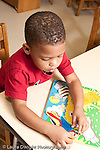 Education preschool 3 year olds boy playing with puzzle vertical