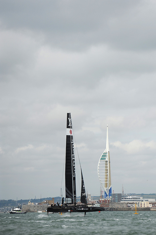 SoftBank Team Japan races past the Emirates Spinnaker Tower during day two of the Louis Vuitton America's Cup World Series racing, Portsmouth, United Kingdom. (Photo by Rob Munro/Stewart Communications)