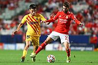 29th September 2021: Estadio da Luz, Lisbon, Portugal;  UEFA Champions league group E,  S.L.Benfica versus Barcelona; Pedri FC Barcelona is held off by Rafa Silva S.L.Benfica