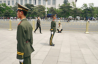 China. Province of Beijing. Beijing. Tiananmen Square. Two policemen check the crowd on the feast of the first of may.  © 2004 Didier Ruef /