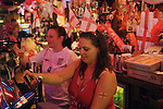 Pub interior women pulling pints of beer, interior decorated with English union jack flags celebrating World Cup football match 2006 2000s