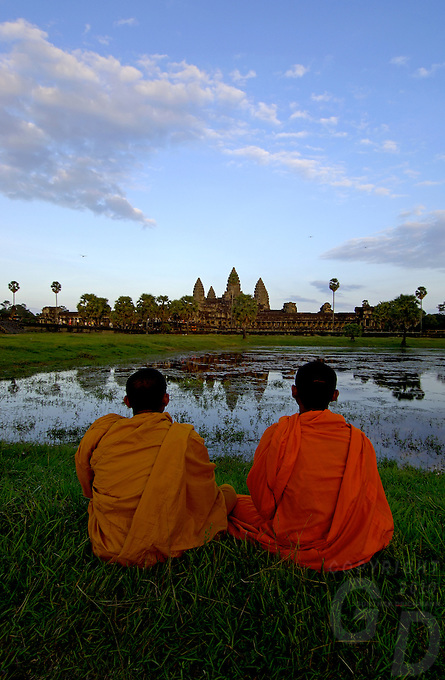 Images from the Book Journey Through Colour and Time,<br /> Buddhist Monks enjoying the Sunset over Ankor Wat,Cambodia