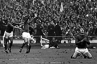 30.07.1966 Wembley Stadium, London England. George Cohen (England) sinks to his knees in celebration in front of  Roger Hunt and Martin Peters; England beat Germany by a score of 4-2