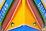 Traditional boats with eyes look like faces by Sandro Santioli