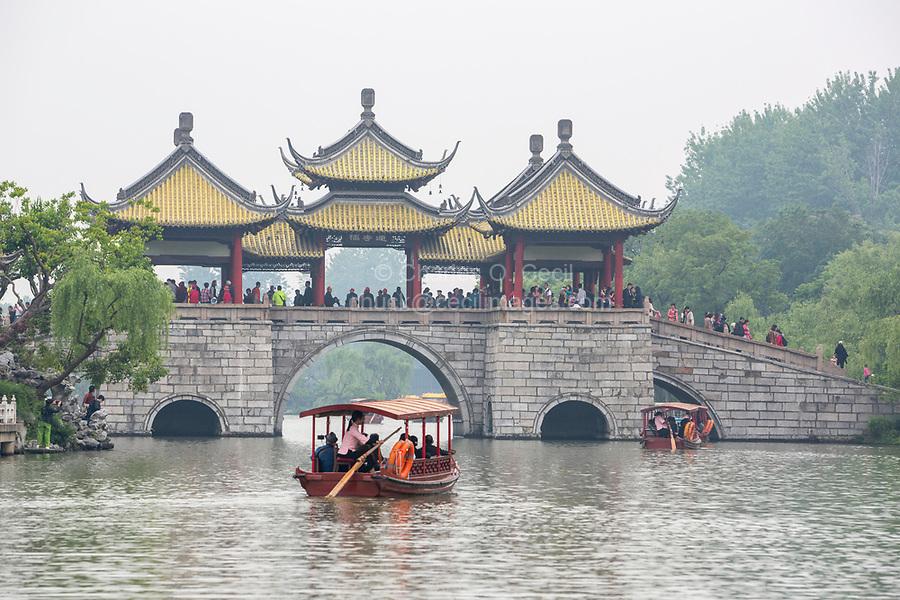 Yangzhou, Jiangsu, China.  Pleasure Boats Approaching Five Pavilion Bridge, Slender West Lake Park.
