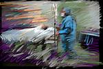 surgeon wheeling patient on gurney with IV